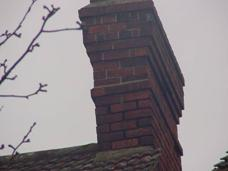 Weathered pointing to chimney which needs repointing in a correct mortar