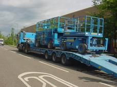Scissor lifts being transported