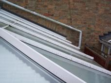 Glass roof with plastic coated metal frame